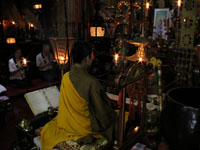 Prayer in main hall of temple